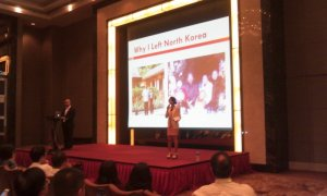2013-07-19: Sharing the stage at the Shanghai Austrian Economics Summit. They also took some time to embrace her, then she became the star of the conference.